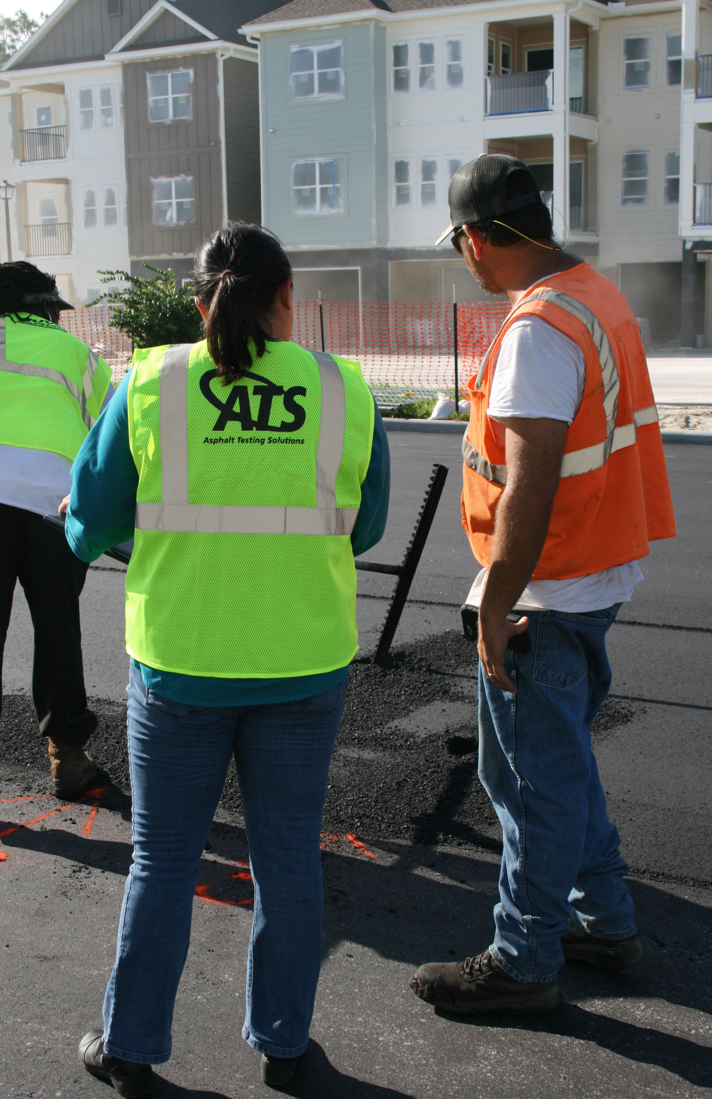 Pavement Materials Engineer Tanya Nash consults asphalt contractor during paving