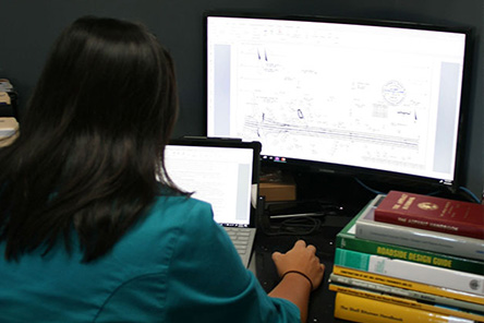 An engineer reviewing testing plans on a computer