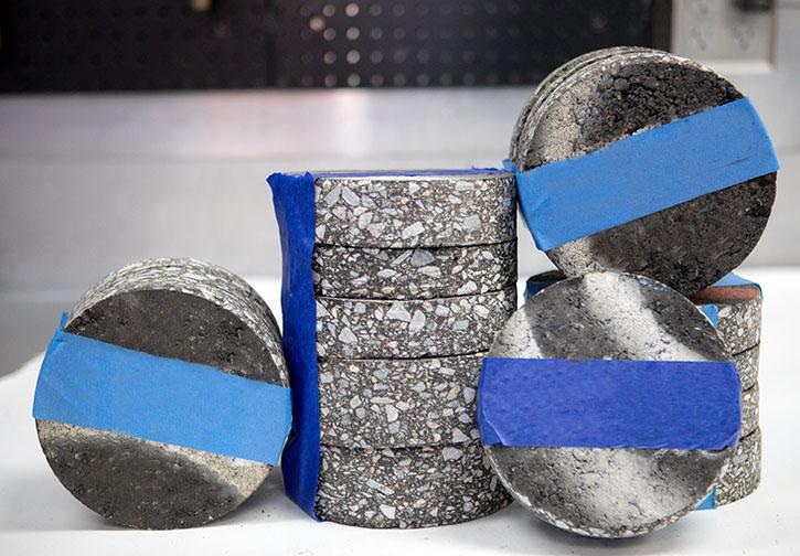A stack of asphalt core samples