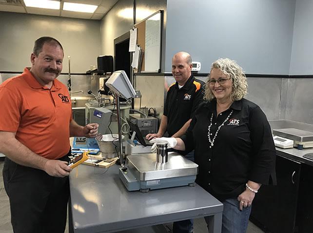 Three Asphalt Testing technicians in the lab