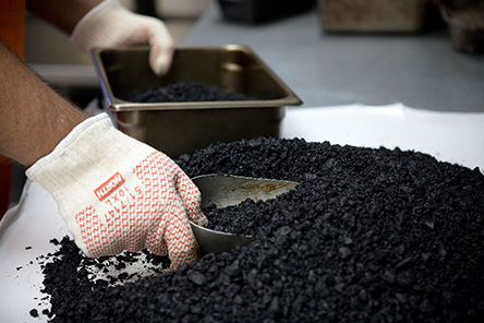 Scooping an asphalt sample for testing