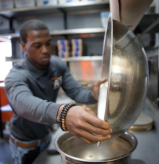 Lab Technician pouring a bowl