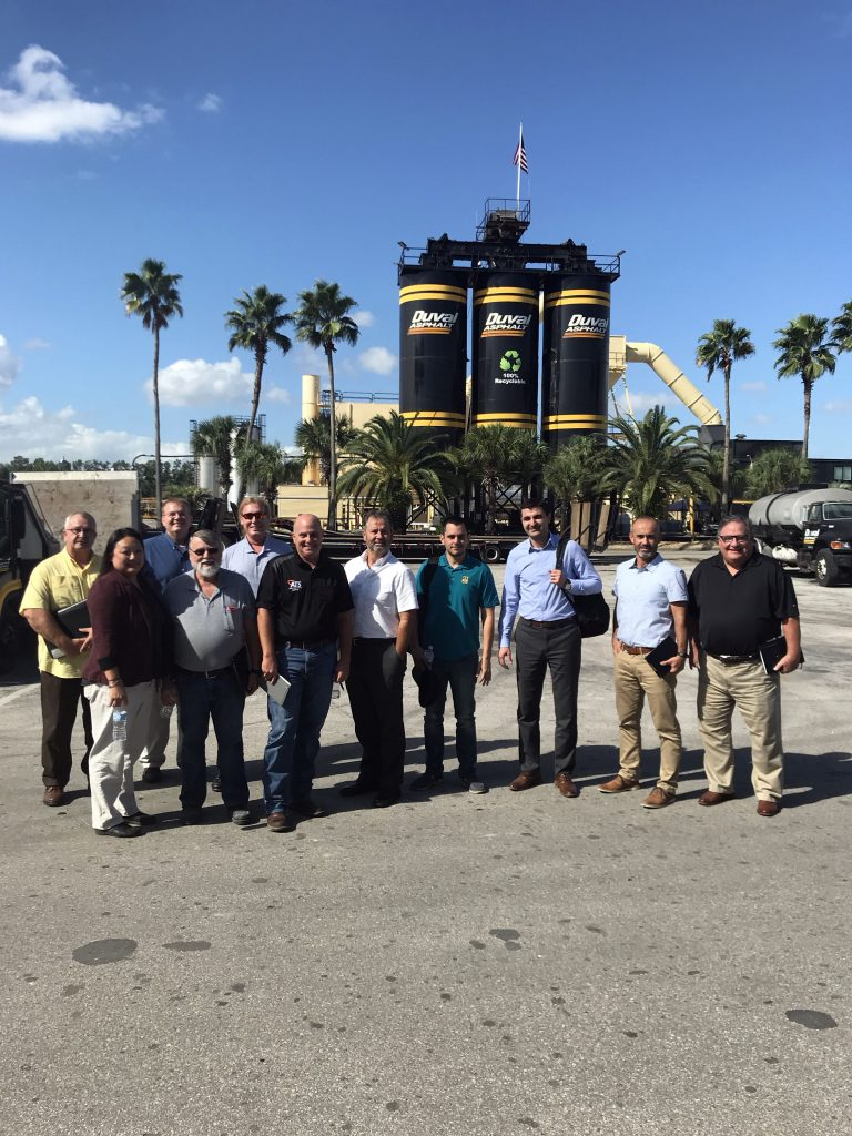 Members of the Asphalt Contractors Association of Florida meet for Asphalt Performance Testing task group in front of asphalt contractor's asphalt plant.
