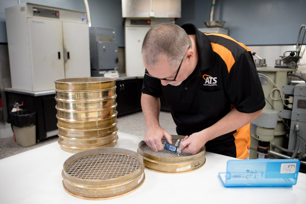 ATS Lab technician calibrating mechanical sieves